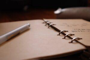 white pen on white paper